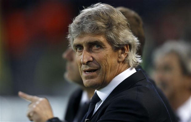 Malaga's coach Pellegrini is pictured before Champions League quarter-final second leg soccer match against Borussia Dortmund in Dortmund...Malaga's coach Manuel Pellegrini is pictured before the Champions League quarter-final second leg soccer match against Borussia Dortmund, in the western German city of Dortmund April 9, 2013.      REUTERS/Ina Fassbender (GERMANY  - Tags: SPORT SOCCER)