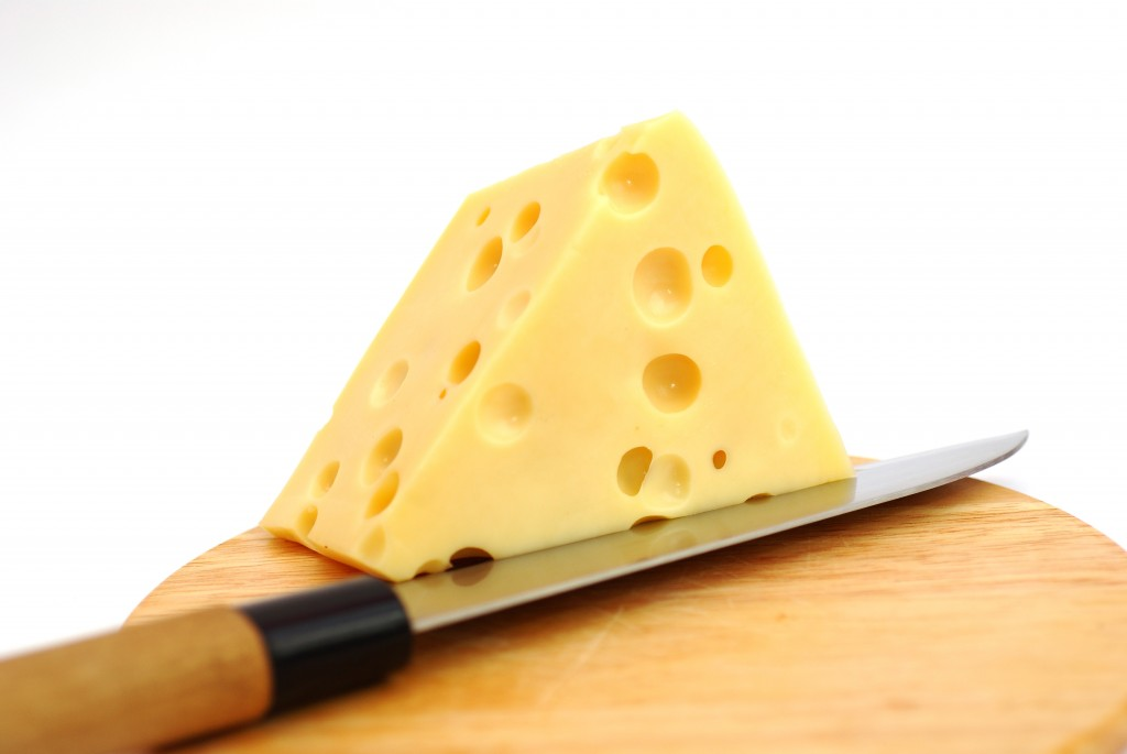 Piese of cheese on a white background